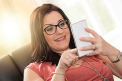 Surprised beautiful young woman watching her mobile phone, light effect Stock Photos