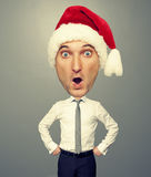 Surprised bighead man in santa hat Stock Photo