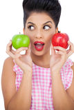 Surprised black hair model holding apples Royalty Free Stock Images