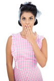 Surprised black hair model posing covering her mouth Royalty Free Stock Photo