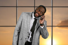 Surprised black man with phone. Stock Photography