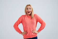 Surprised blond in sweater. Studio shot Royalty Free Stock Photos