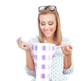 Surprised blond woman holding shopping bags Stock Image