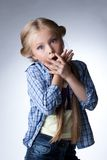 Surprised blonde girl in jeans Royalty Free Stock Photos