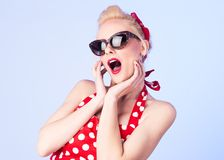 Surprised pin up girl with a vintage dress royalty free stock photos