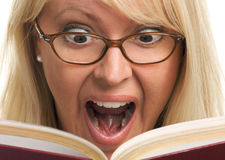 Surprised Blonde Reads a Book Royalty Free Stock Images