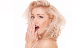 Surprised blonde woman Stock Photo