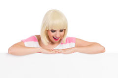 Surprised Blonde Woman Behind A Banner Stock Images
