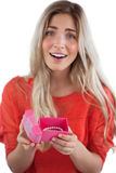 Surprised blonde woman opening gift. On a white background Stock Photo