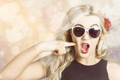 Surprised blonde woman with retro hair and makeup Stock Photo