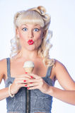 Surprised blue eyed fifties style retro pinup with ice cream cor Stock Images
