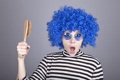 Surprised blue hair girl with comb. Stock Photo