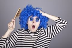 Surprised blue hair girl with comb. Royalty Free Stock Photos