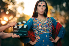 Surprised Bollywood Actress Wearing an Indian Outfit and Jewelry. Professional cinema star shooting a scene Stock Image