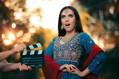 Surprised Bollywood Actress Wearing an Indian Outfit and Jewelry. Professional cinema star shooting a scene Royalty Free Stock Photo