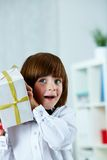 Surprised boy. Photo of surprised boy with giftbox Royalty Free Stock Photo