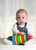 Surprised boy. With pyramid in his hands Royalty Free Stock Image