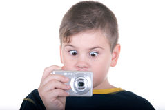 Surprised boy with  camera. On  white background Stock Photography