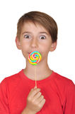 Surprised boy with candy Royalty Free Stock Image