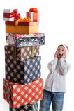 Surprised boy and christmas presents Royalty Free Stock Image