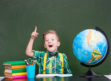 Surprised boy in classroom.  Royalty Free Stock Photo
