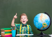 Surprised boy in classroom.  Stock Images