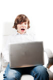 Surprised boy with computer Royalty Free Stock Images