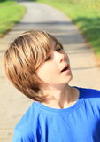 Surprised boy. Face of a surprised little boy in blue t-shirt Stock Photography