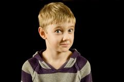 Surprised boy, isolated on black. Surprised young boy, isolated on black Stock Photo