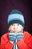 Surprised boy keeping warm Stock Image