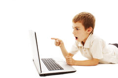 Surprised boy with laptop Royalty Free Stock Photos