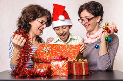 Surprised boy looking in Christmas present box Stock Image