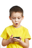 Surprised boy looking at phone Stock Images