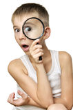 Surprised boy with magnifying glass Stock Photo
