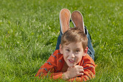 Surprised boy on the meadow Stock Photography