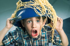 Surprised boy with pasta Royalty Free Stock Photos