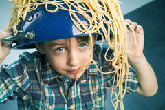 Surprised boy with pasta Stock Photos