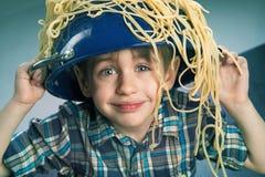 Surprised boy with pasta Stock Photos