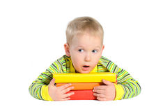 Surprised boy with pile of books Royalty Free Stock Image
