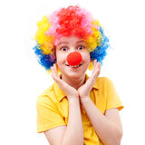 A surprised boy with a red clown nose Stock Images