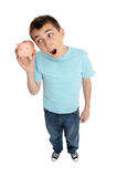 Surprised boy shaking money box stock photos