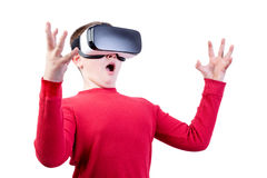 Surprised boy wearing virtual reality glasses Royalty Free Stock Photos