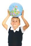 Surprised boy with world globe. Surprised boy holding world globe on head isolated on white background Stock Images