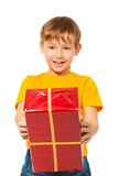 Surprised boy with wrapped box Royalty Free Stock Photography