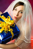 Surprised bride with a present Royalty Free Stock Photos