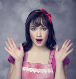Surprised brunette housewife Stock Photography