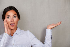 Surprised brunette lady showing open mouth gesture Royalty Free Stock Photo