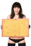 Surprised brunette taking vintage yellow board Stock Photos