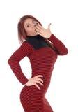 Surprised brunette woman in dress. Stock Photo