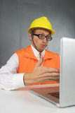 Surprised builder with computer. Stock Images